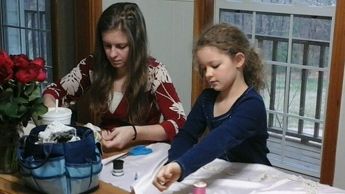 Rachel and Abigail sewing