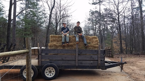 James and Gideon helping with hay