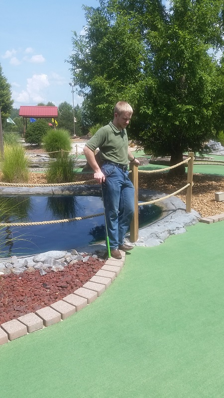 Jonathan playing mini golf