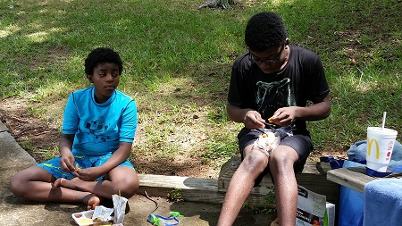 Korpu and BJ eating lunch at the lake with Buzz Away on