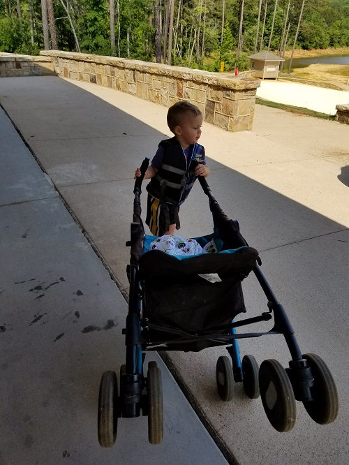 Titus pushing the stroller